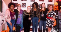 On the Orange Carpet, (from left) 'Boy Toy' writer/director Destiny Macon, 'Tell Tale Heart: Sisters' director Christine Parker, 'Tell Tale Heart: Sisters' star Carrie Jones, official sponsor Courtney Gallop, 'Scream Until You Like It' producer Amanda Duncan, and festival co-founder and host Sue Artz, photographed on the at the 3rd Halloween International Film Festival on October 27, 2018 by Matt Artz for OBX Entertainment/Halloween Daily News.