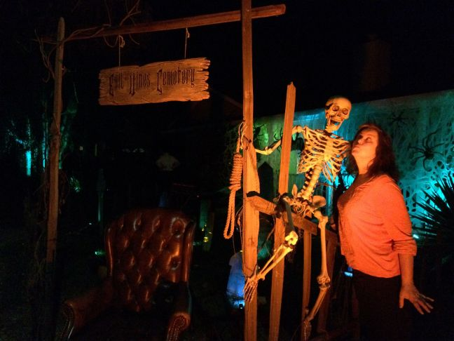 Evil Vines Cemetery Outdoor Yard Haunt Posing With Skeleton at Entrance Gate