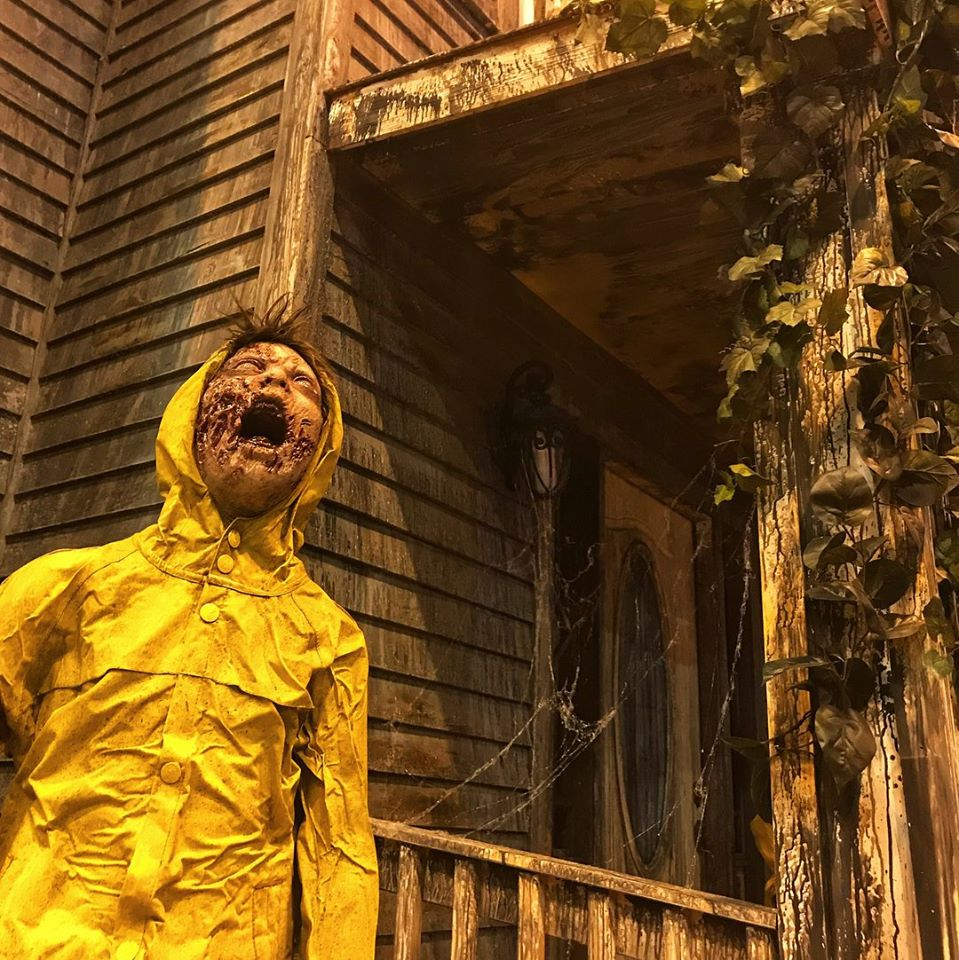 Fright Kingdom Scariest Haunted House in the US Zombie Child Screaming In Rain Coat