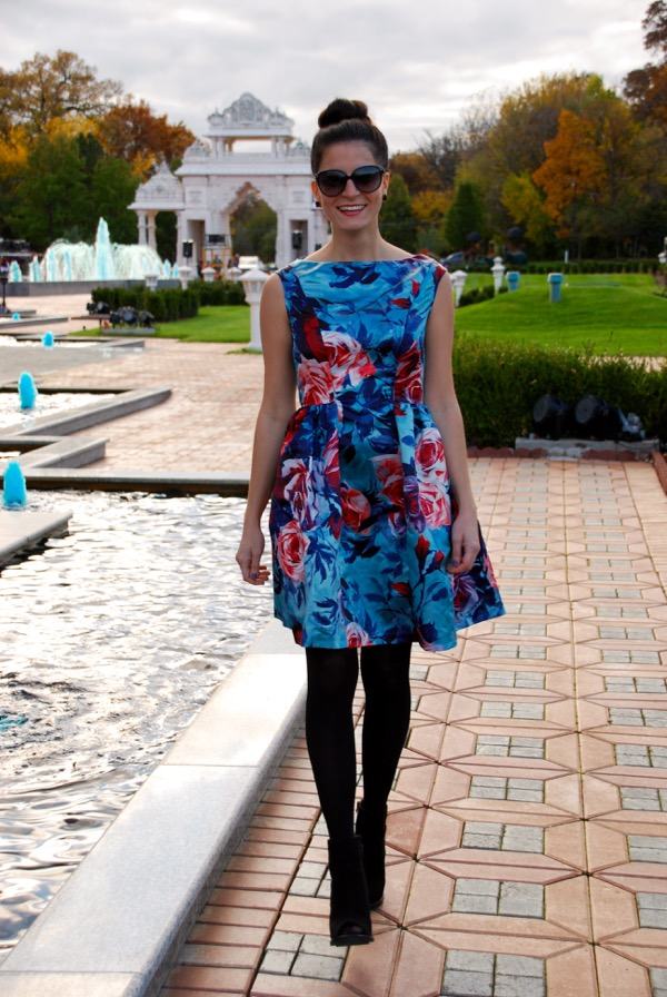 sunset in a floral print dress walking