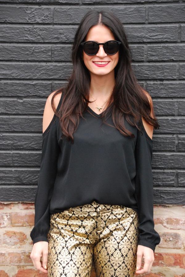 smiling portrait black cold shoulder top