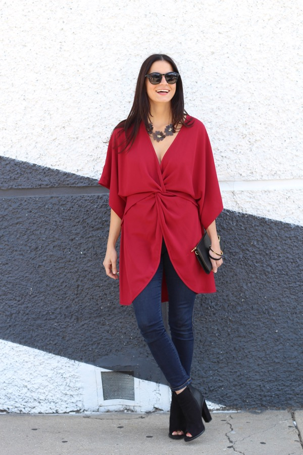 laughing in a red wrap dress as a top