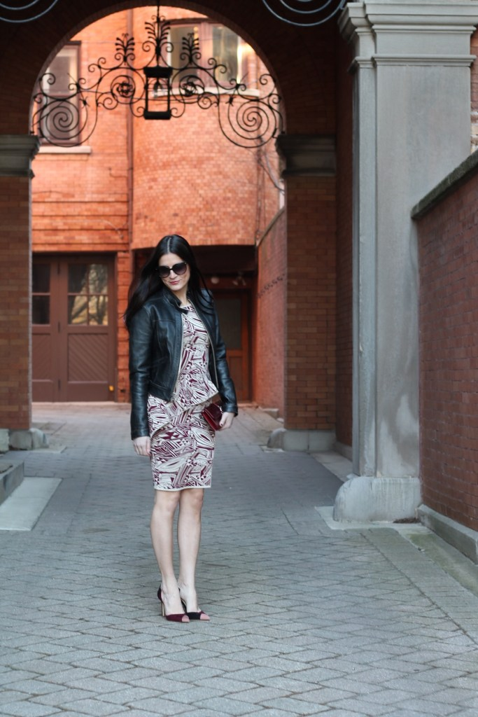 plum peplum dress with pink toe heels and leather moto jacket