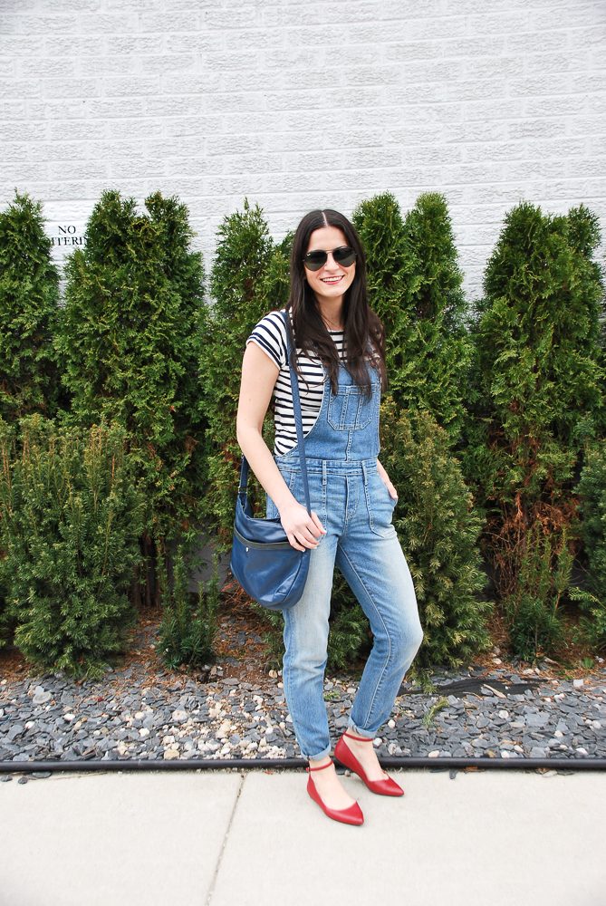 denim overalls and pointy red flats