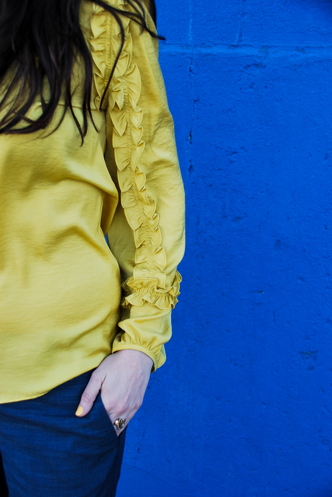 long sleeve yellow shirt with ruffles
