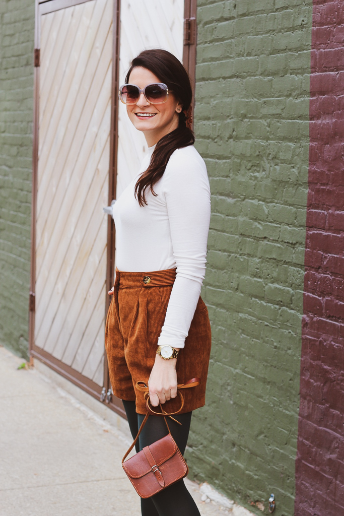 camel corduroy high waisted shorts and green tights