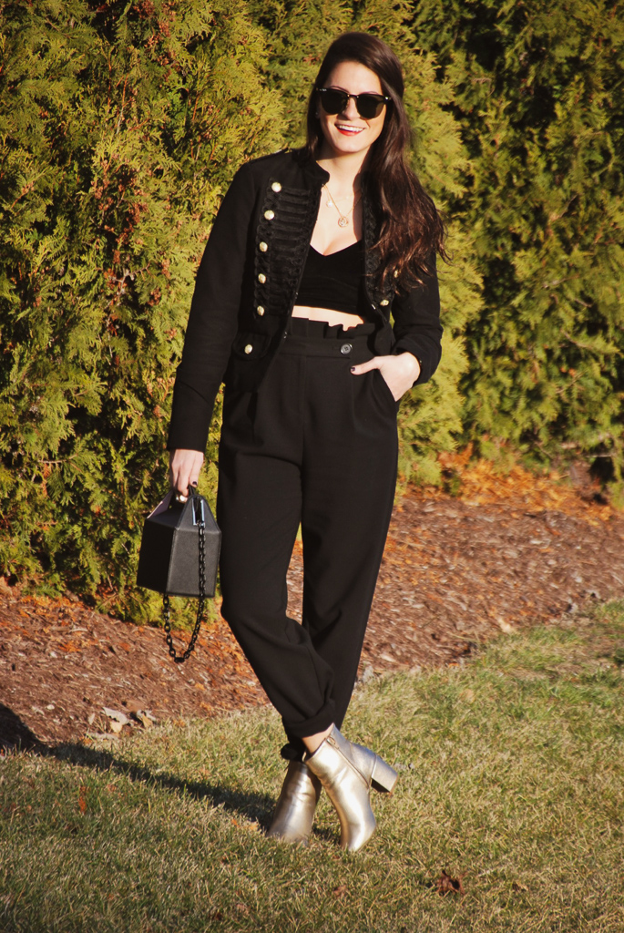 black velvet bralette, black trousers and black jacket