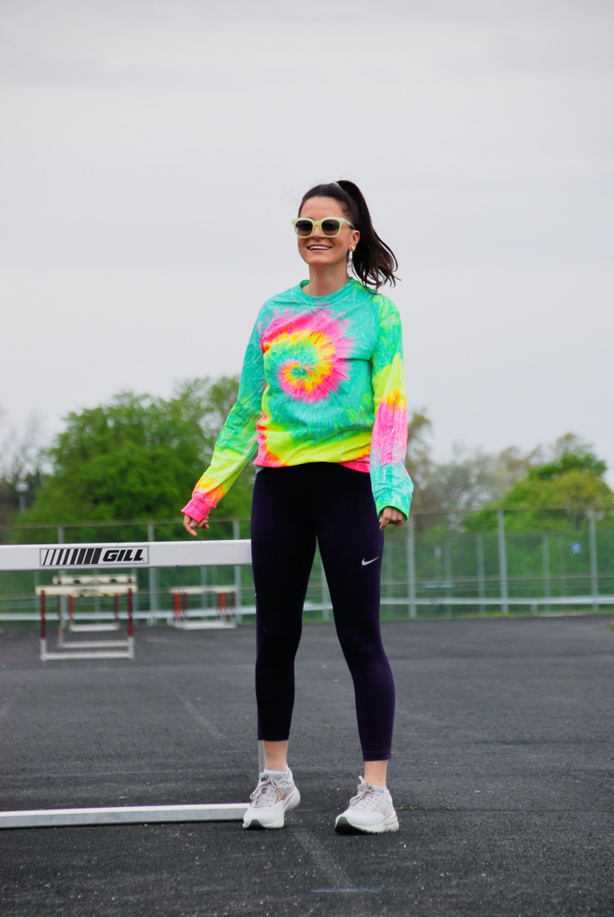neon tie dyed long sleeve shirt and neon lime sunglasses
