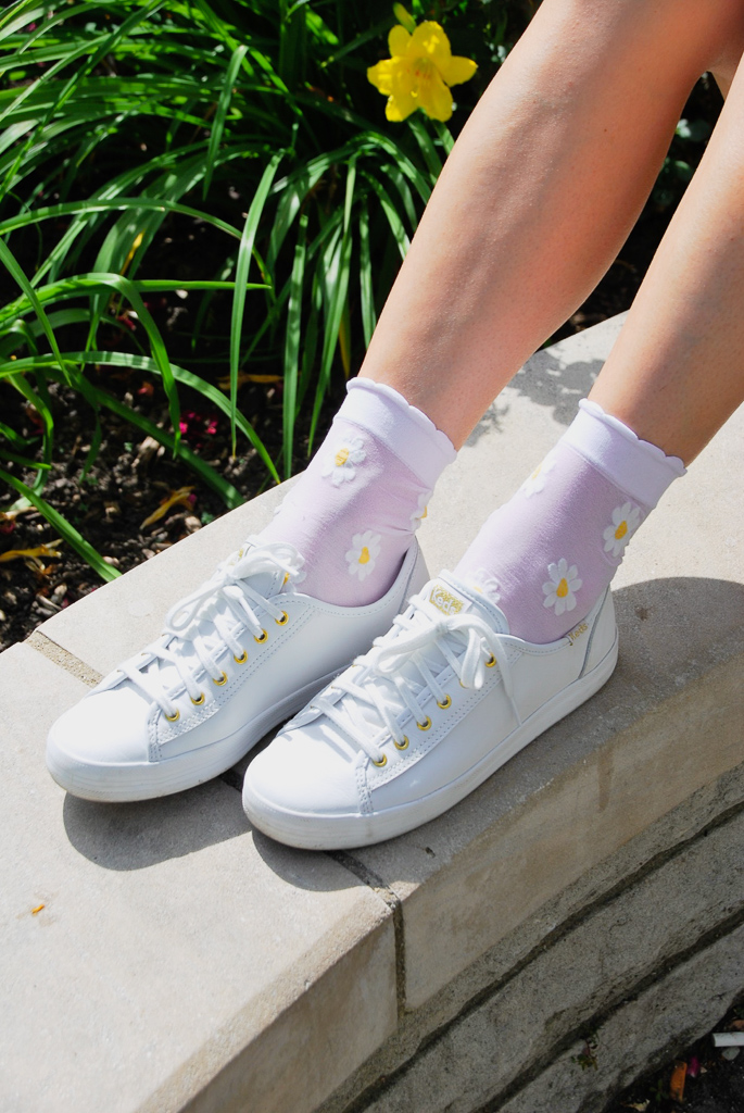 white sneakers with gold accents and ankle floral socks