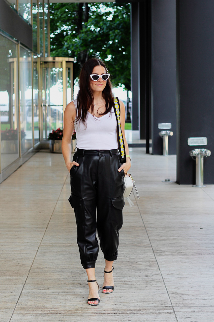 white bodysuit and black pleather cargo pants