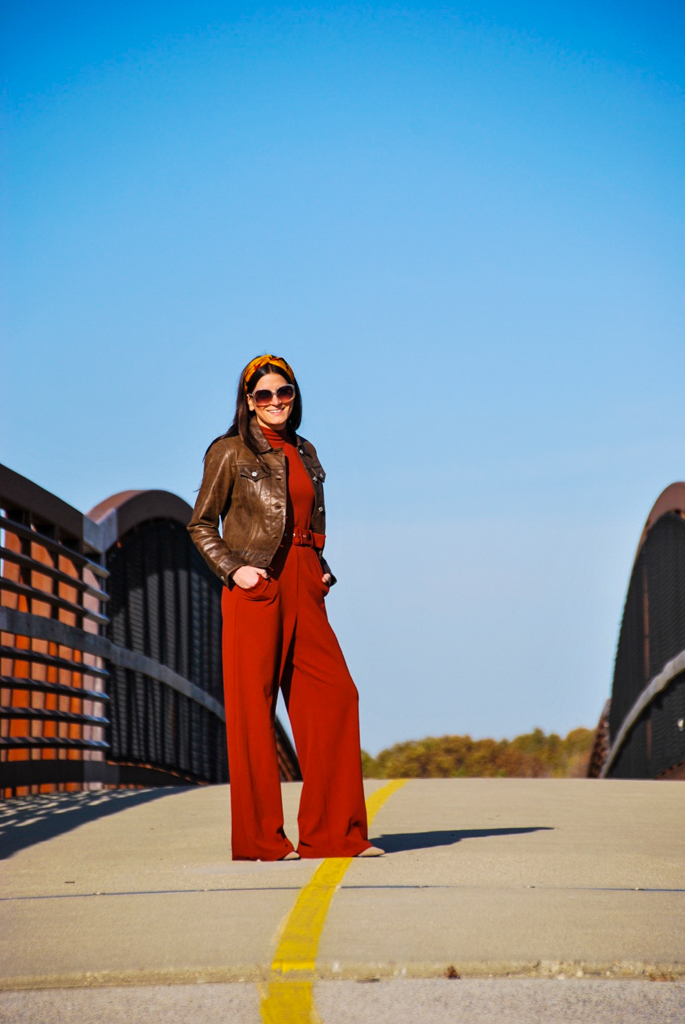 leather jacket and jumpsuit combination