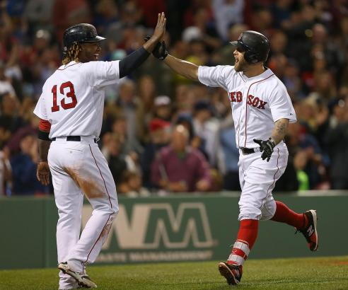 BOSTON, MA - MAY 23: Mike Napoli #12 of the Boston Red Sox celebrates his second home run of the game with Hanley Ramirez #13 against the Los Angeles Angels in the sixth inning at Fenway Park on May 23, 2015 in Boston, Massachusetts. (Photo by Jim Rogash/Getty Images)