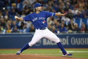 R.A. Dickey throws a pitch during the first inning of a game against the Atlanta Braves at Rogers Centre on April 18, 2015 (Tom Szczerbowski/Getty Images)