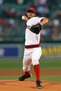 Rick Porcello - wearing a 1975-era throwback uniform, throws a pitch during the first inning of a game against the Tampa Bay Rays at Fenway Park on May 5, 2015 (Jim Rogash/Getty Images)