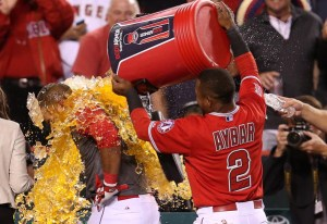 Carlos Perez is doused with sports drink by Erick Aybar after hitting a walk off home run to win a game against the Seattle Mariners at Angel Stadium on May 5, 2015 (Stephen Dunn/Getty Images)