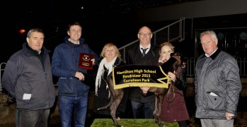 Eoghan O'Leary making a presentation to Maura Kiely, Blackrock, following Mimis Ace's win in the Halcyon Days Classic 550 at the Hamilton High School 75 th. Anniversary Race Night at Curraheen Park. Included are John Kiely, trainer, Eugene O'Brien, Acting Principal, Megan Faul, handler and Eamonn Kiely. Picture: Mike English