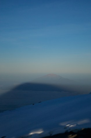 Kili's morning shadow pointing out Mt Meru