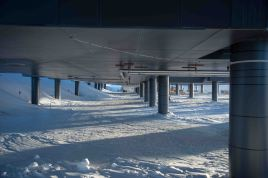 Station legs to allow wind to scour out drifting snow