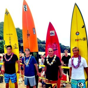 Evan Valiere, Shane Dorian, Kelly Slater, Keoni Watson at the Eddie Aikau Opening Ceremony at Waimea Bay on North Shore of Oahu, Hawaii