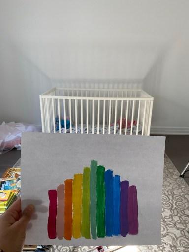 Rainbow wall mural mock up against the nursery backdrop