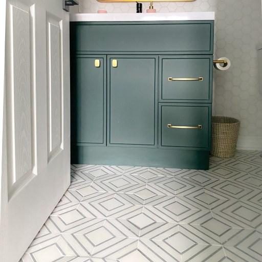Green bathroom vanity with gold handles