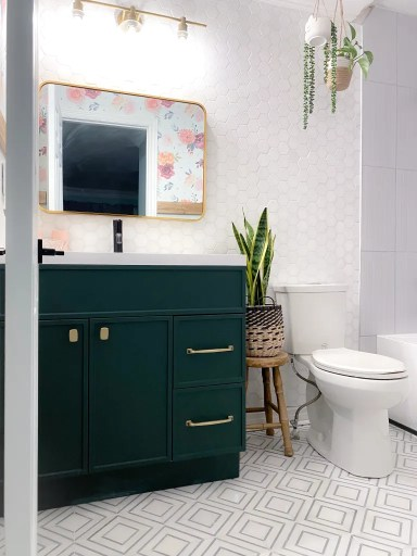 Bathroom with hexagon wall tiles, green vanity and pattern floor tile