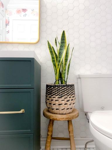 Upclose of hexagon backsplash and green bathroom vanity