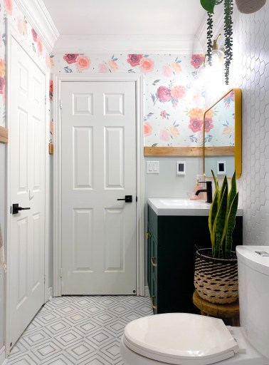floral wallpaper in a girls bathroom