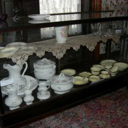 display case with comode china dining rm.
