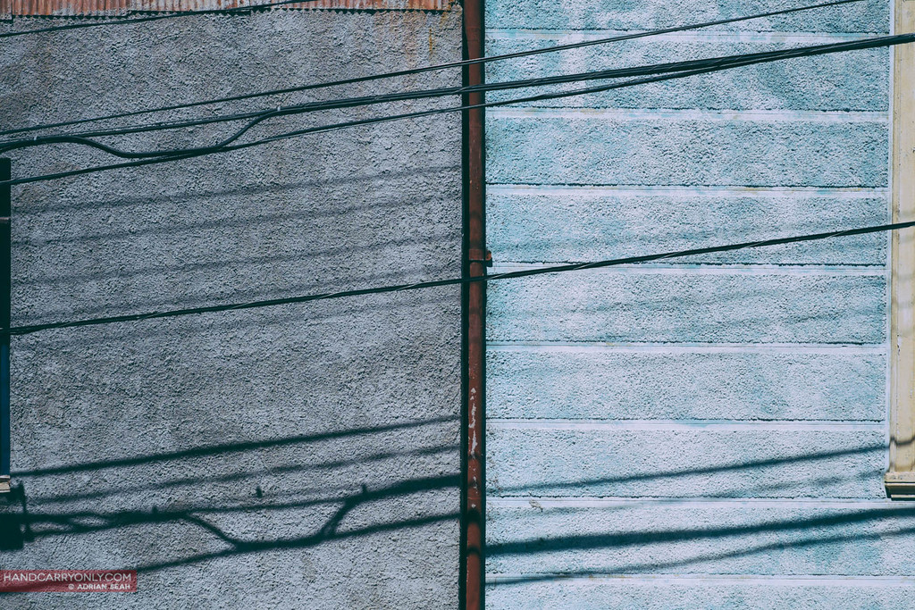 shadow of cables on blue walls, valparaiso, chile