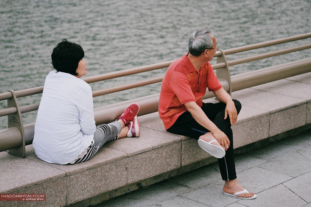 old couple by singapore river