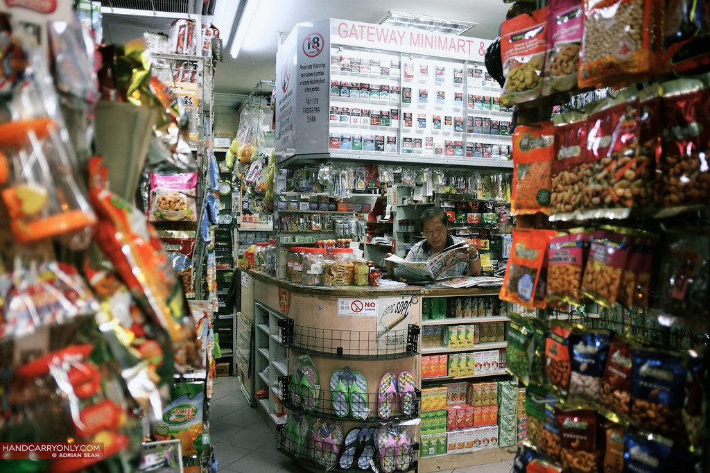 provision shop owner reads newspapers in his shop