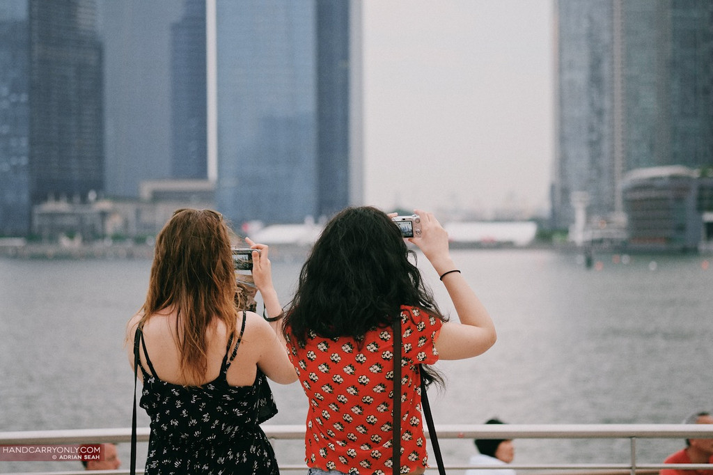 2 tourist girls taking photos