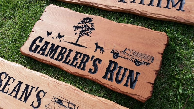 picture of a rustic custom wood sign with engraved pictures