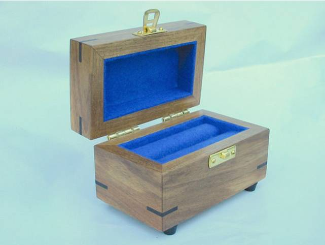 Photo of a small wooden box for a rare stone, lid is open.