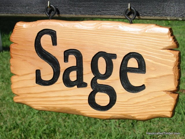 Close up of wooden name signs for dog kennel