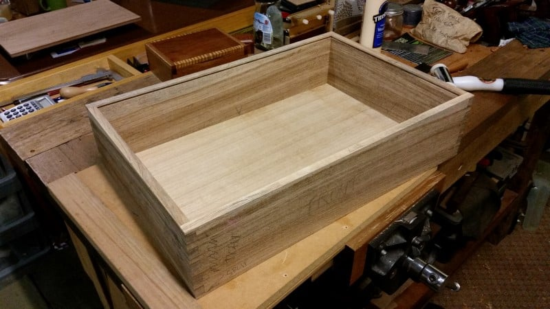 Testing the base in the slots of the case sides.