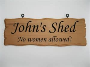 Front view of a rustic man cave sign for a shed