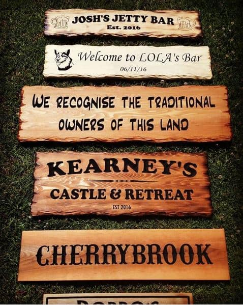 wooden signs and plaques in various styles including rustic cedar and burnt with flame