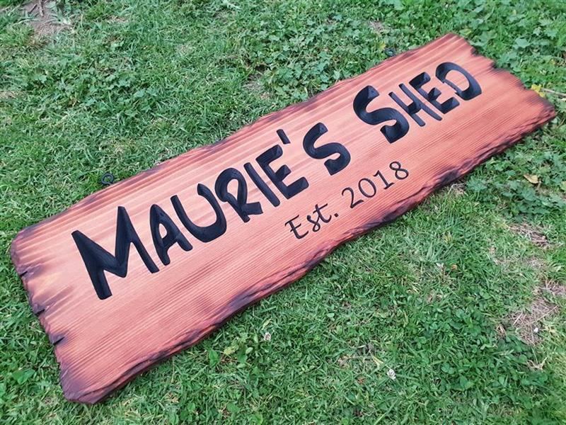 Personalised shed sign example with rustic carved edges scorched with flame