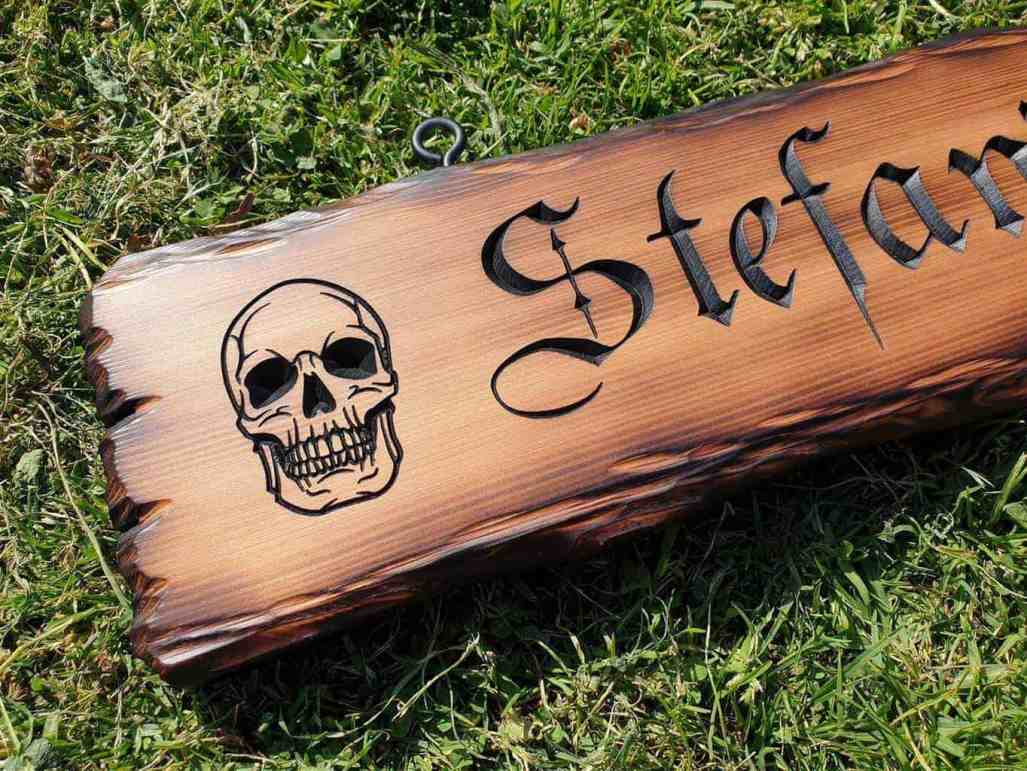 engraved skull wooden bar sign