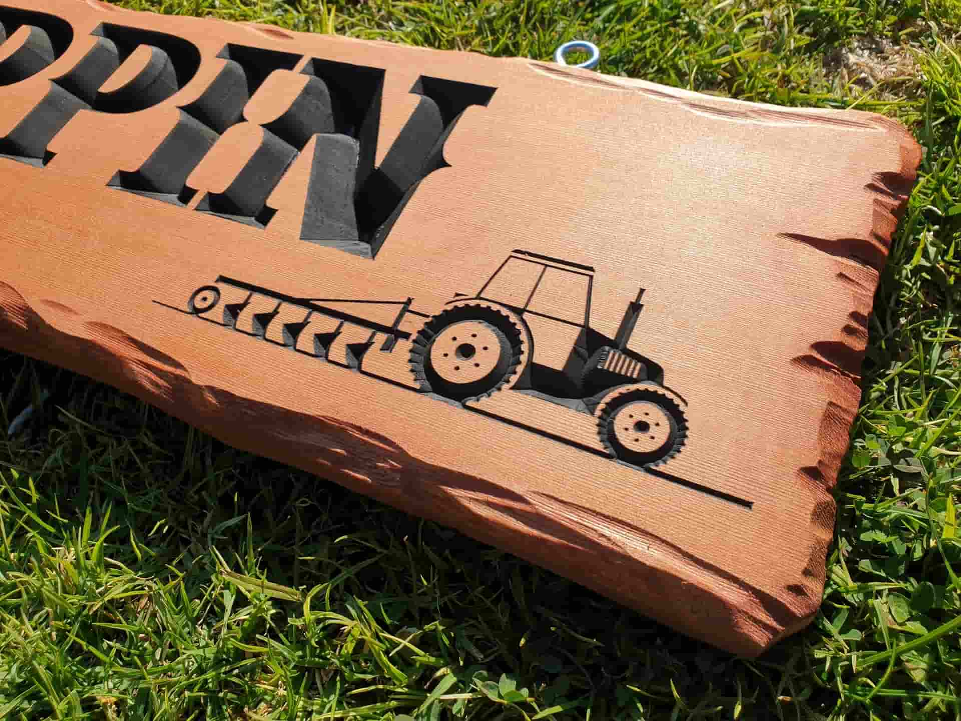 tractor picture engraved into timber