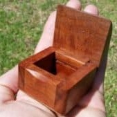 Photo of a small wooden box with lid open