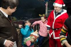Little girl receives her gift :) Courtesy Jon Burke.