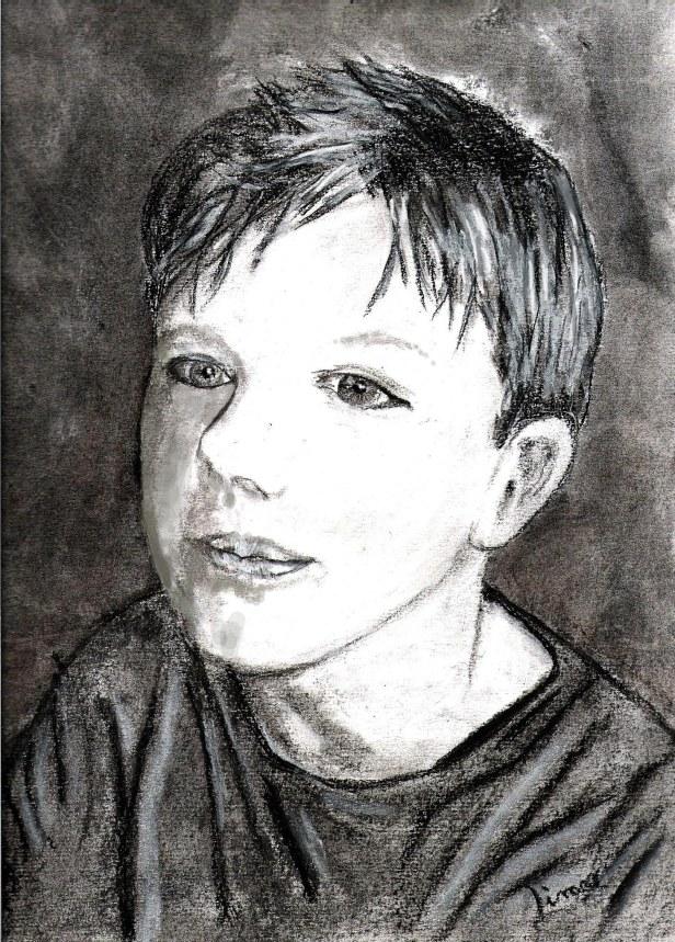 Dessin au fusain de mon fils Robin a 9 ans on voit son visage en gros plan. Légèrement de profil.