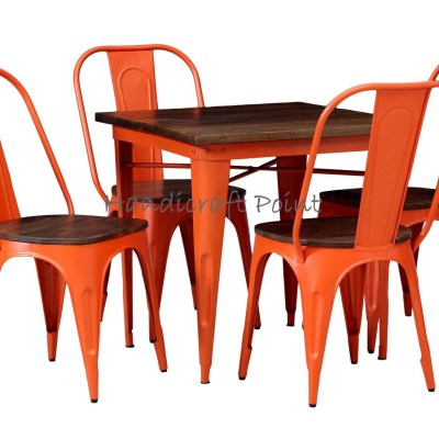 Tolix caf? table with tolix dining chairs in orange color