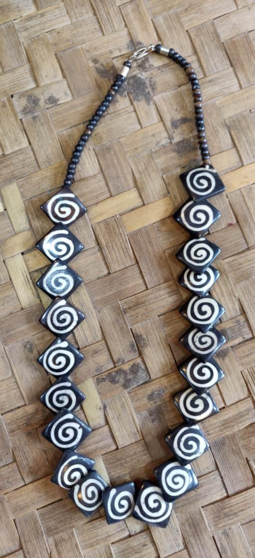 spiral design bone necklace