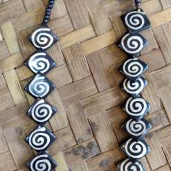 spiral design bone necklace