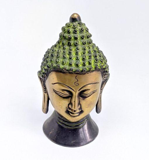 antique buddha head statue