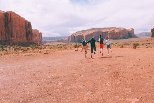 Road Trip Monument Valley Navajo Utah ArizonaRoad Trip Monument Valley Navajo Utah Arizona Friends skipping
